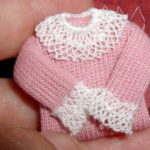 Pink folded sweater lace collar and cuffs